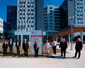 Dignitaries stand outside Cortellucci Vaughan Hospital