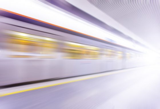 Fast,Train,Traveling,At,High,Speed,Through,A,Station